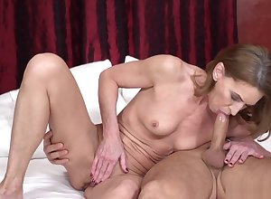 Redhead grandma awaits a facial charges hardcore sexual intercourse